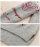 オシャレなデザイン刺繍のニットトップス