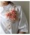 ビジューと花コサージュ華やぐペプラムシャツ